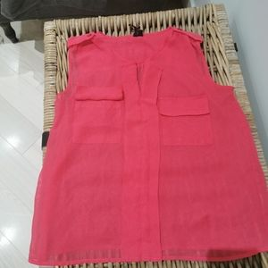 NWOT Material girl sleeveless top with pockets